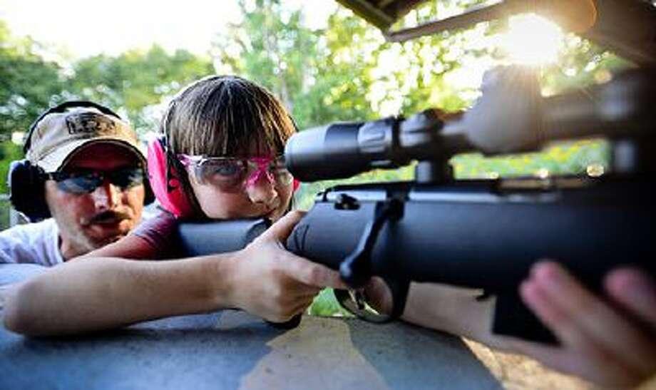 Ken and Haley Herman practice her aim.