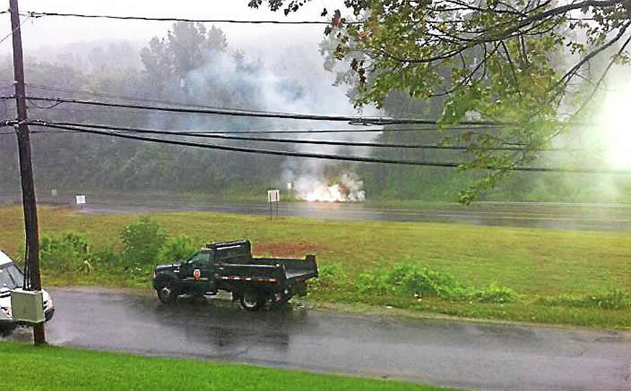 A downed live electric wire caused a fire which shut down part of Route 44 in Winsted late Wednesday morning and left over 600 Connecticut Light and Power customers without electricity, Photo: Contributed Photo