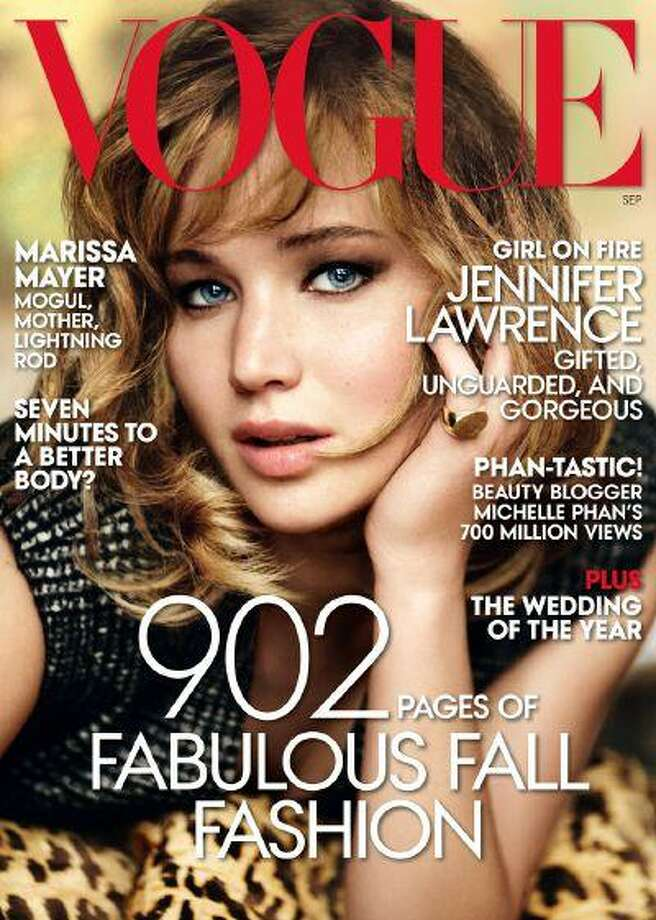 This magazine cover image shot by Mario Testino and released by Vogue shows actress Jennifer Lawrence on the cover of the September 2013 issue. The issue will hit newsstands on Aug. 20.