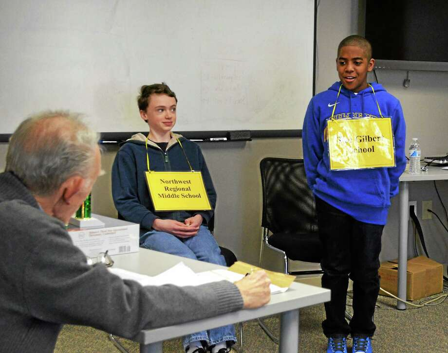 Connor Spencer, left, and Adrian Delacruz, right, compete in the first Register Citizen spelling bee Thursday.  Pete Paguaga - The Register Citizen Photo: Journal Register Co.