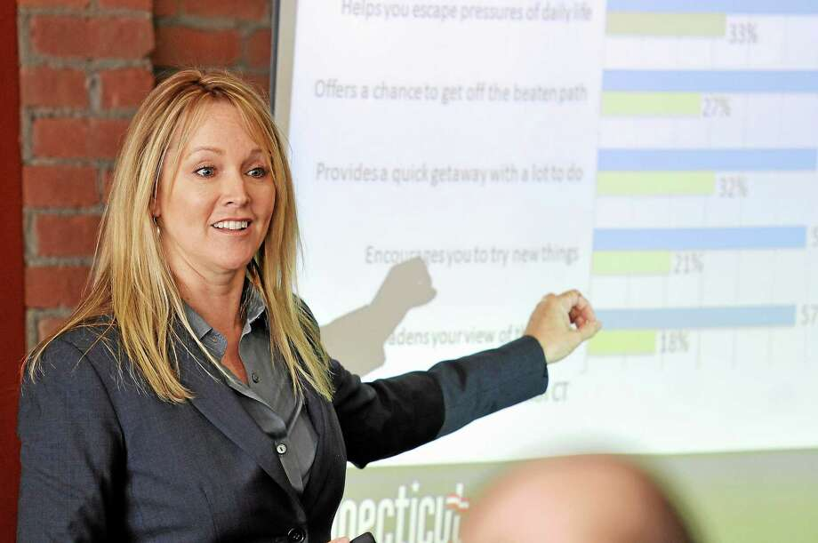 Felicia Lindau, chief business development officer with the Adams and Knight marketing agency, speaks to area business owners during a meeting on the state's marketing plan at the Warner Theatre Thursday. Photo: Laurie Gaboardi — Register Citizen