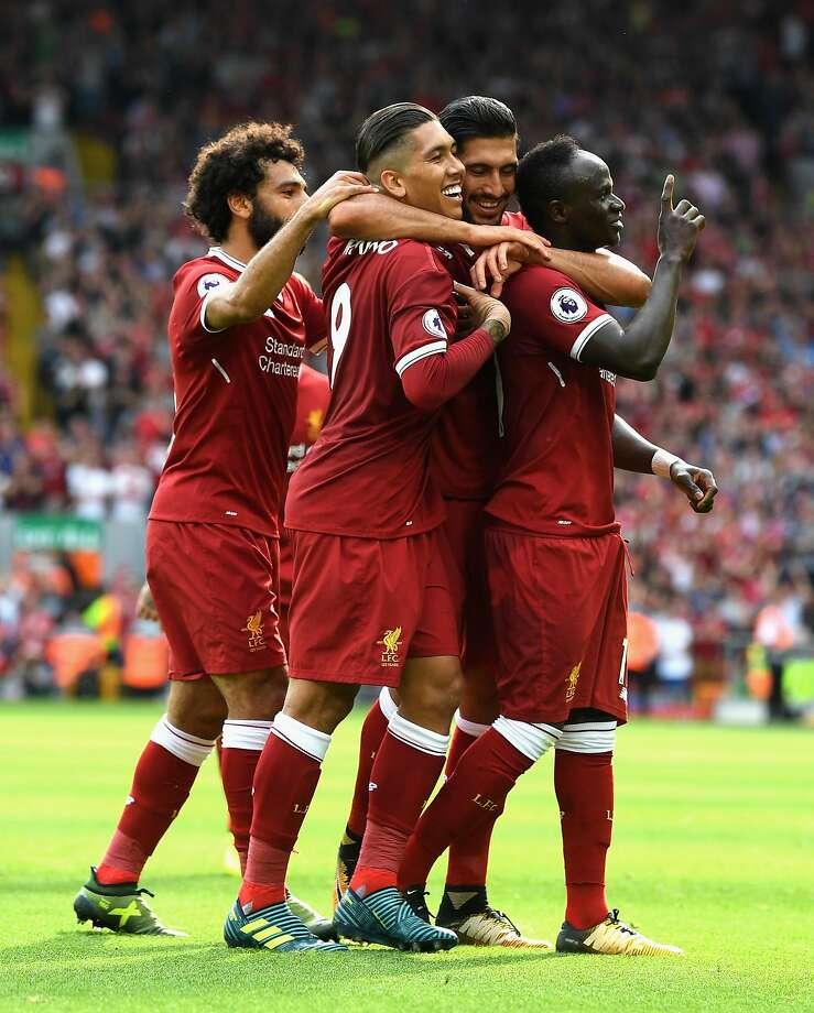 Liverpool's Sadio Mane (right) celebrates his goal at Anfield. Photo: Michael Regan, Getty Images