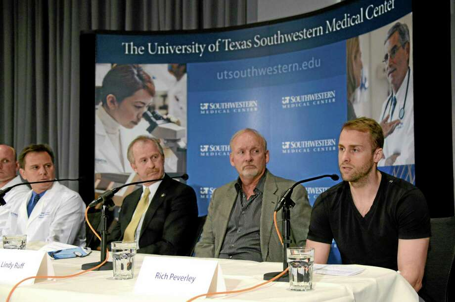 Dallas Stars forward Rich Peverley, right, makes a statement regarding his health and the incident which occurred in a recent game during a news conference at UT Southwestern Medical Center on Wednesday in Dallas. Stars coach Lindy Ruff, general manager Bill Nill and team medical services director Dr. Robert J. Dimeff, M.D., left, look on. Photo: Tim Sharp — The Associated Press  / FR62992 AP