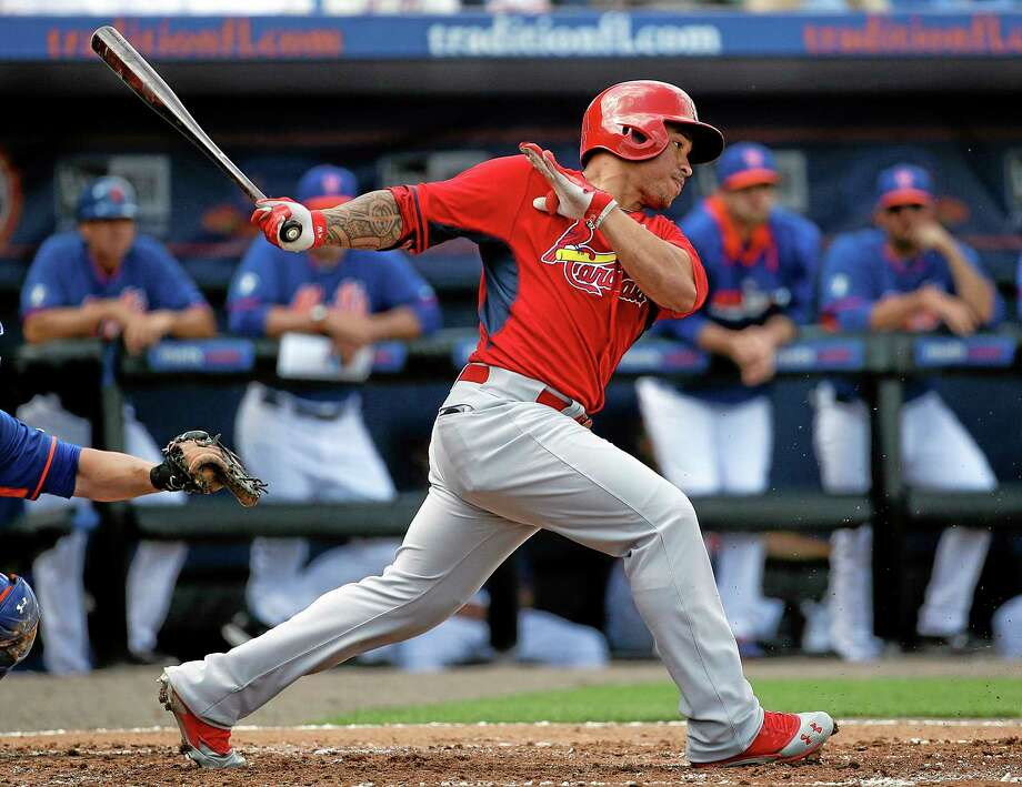 St. Louis Cardinals second baseman Kolten Wong hits a single in the second inning of a spring training win against the New York Mets on Wednesday in Port St. Lucie, Fla. Photo: David Goldman — The Associated Press  / AP