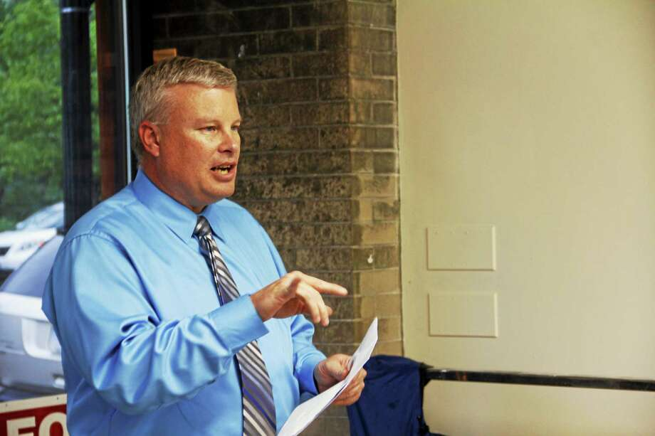 Town Manager Dale Martin addresses a crowd during a budget information meeting in Winsted in May 2013. Photo: REGISTER CITIZEN FILE PHOTO