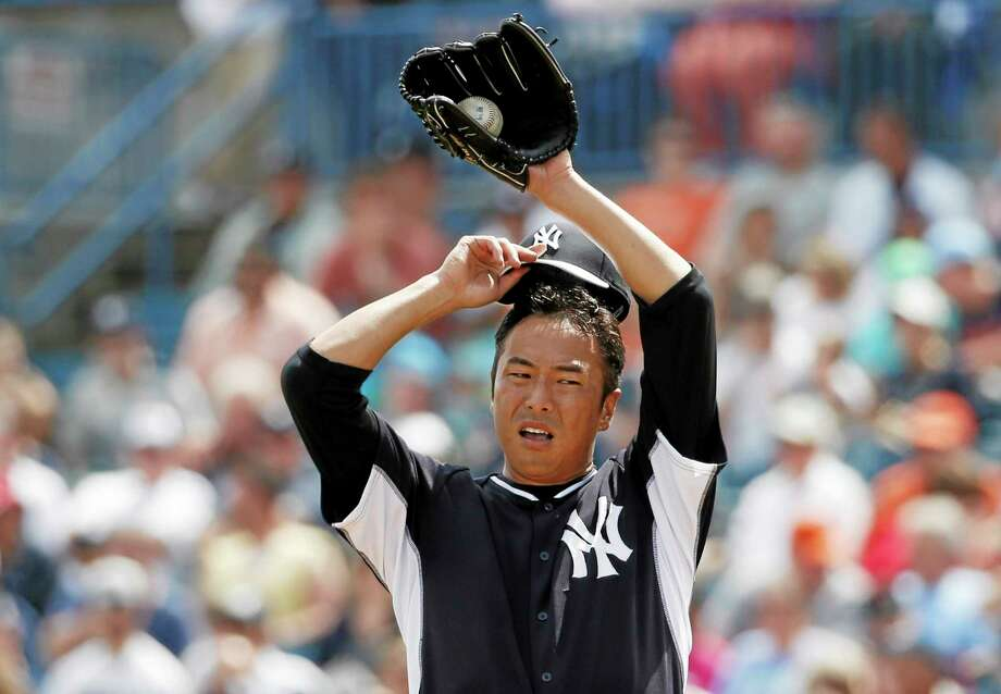 New York Yankees starting pitcher Hiroki Kuroda allowed four runs in the first inning of a spring training game against the Detroit Tigers in Tampa, Fla., on Wednesday. Photo: Kathy Willens — The Associated Press  / AP