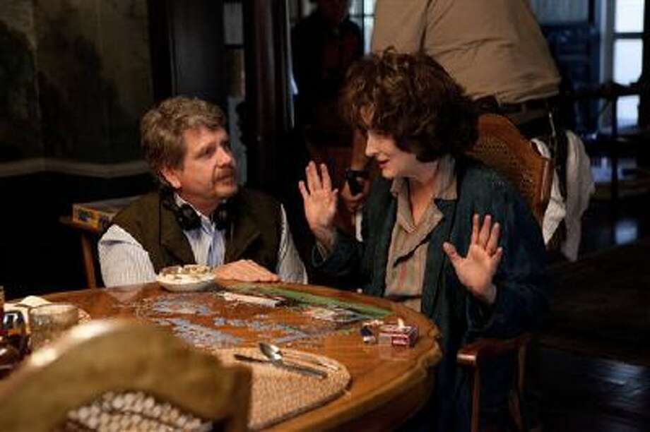 """This image released by The Weinstein Company shows director John Wells, left, and actress Meryl Streep during the filming of """"August: Osage County."""" Streep was nominated for a Golden Globe for best actress in a motion picture musical or comedy for her role in the film. Photo: AP / The Weinstein Company"""