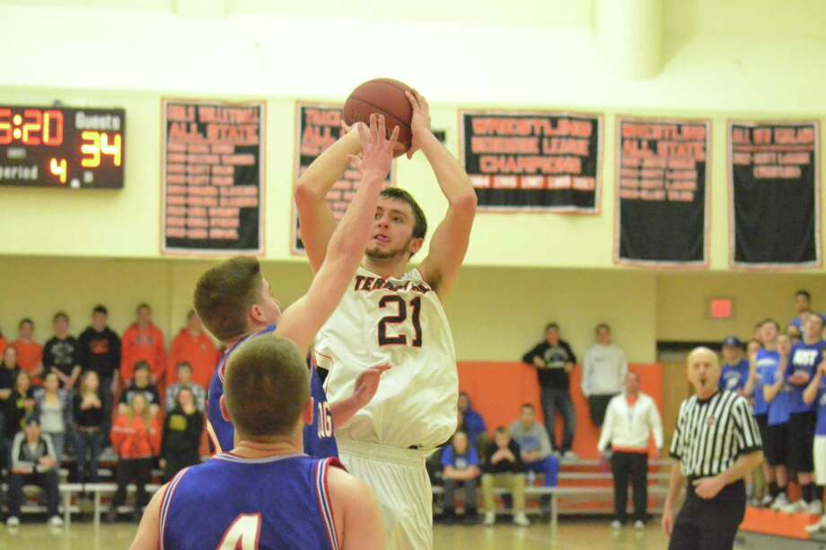 Terryville's Jake Johnson hits a jumper in the Kangaroos 51-41 win over Coginchaug. Photo: Pete Paguaga — Register Citizen