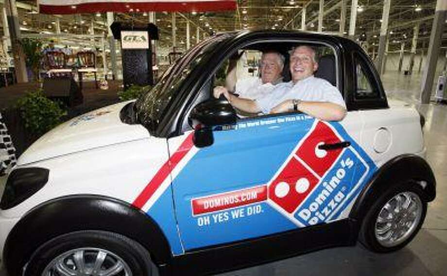 In this July 6, 2012 photograph, former Mississippi Gov. Haley Barbour, left, and then GreenTech Automotive chairman Terry McAuliffe take a drive through the plant after the unveiling of the company's new electric MyCar in Horn Lake, Miss. Today, the place where the plant was to be remains mostly vacant except for a temporary construction trailer. Photo: ASSOCIATED PRESS / AP2012