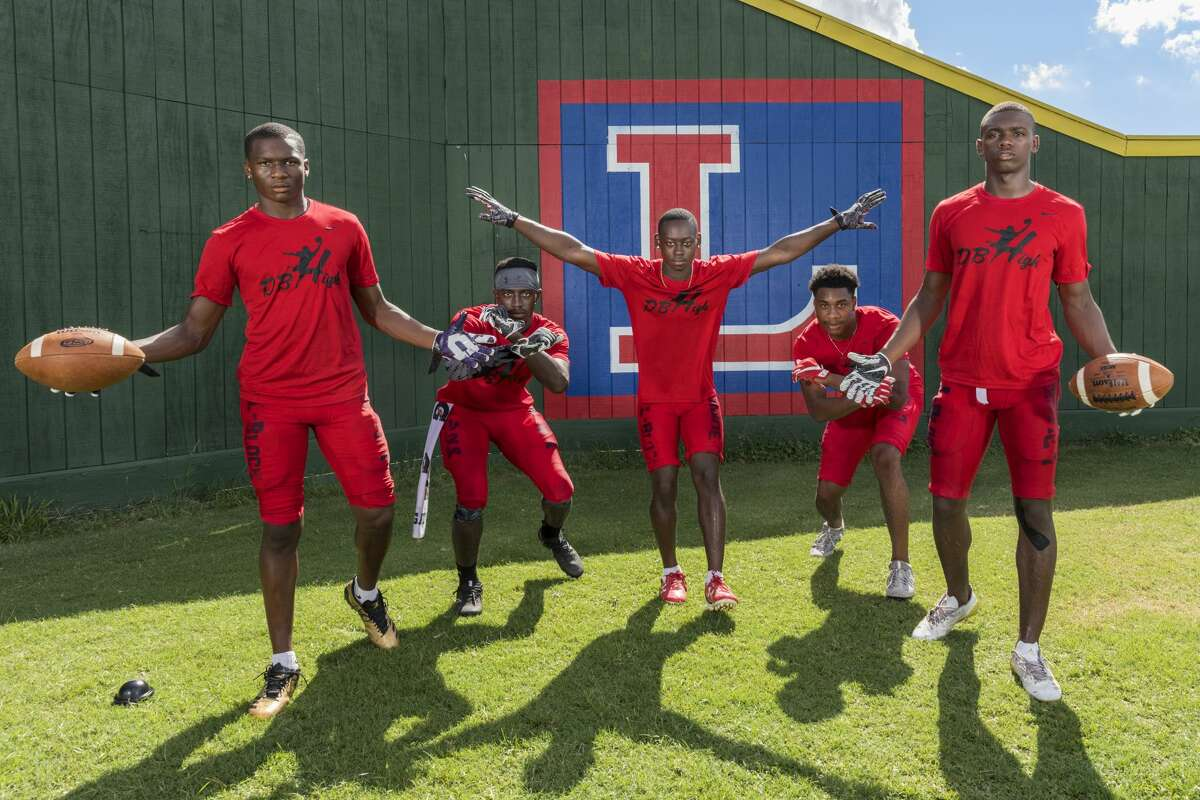 Lamar Texans defensive back pose for a photograph wearing DB High shirts during a preseason practice on Tuesday August 22, 2017. In the photo from left to right are Alex Hogan, D'Shawn Jamison, Quantis Galloway, Zion Burrell, and Anthony Cook.