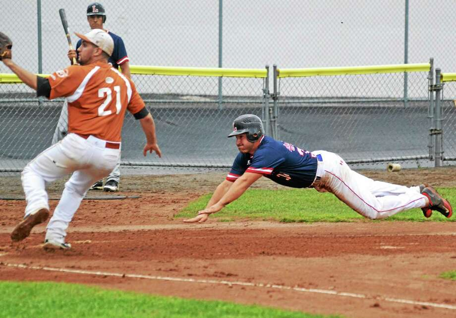 Litchfield's Ed Pequignot dives safely into home plate, scoring on a passed ball. Photo: Pete Paguaga — Register Citizen