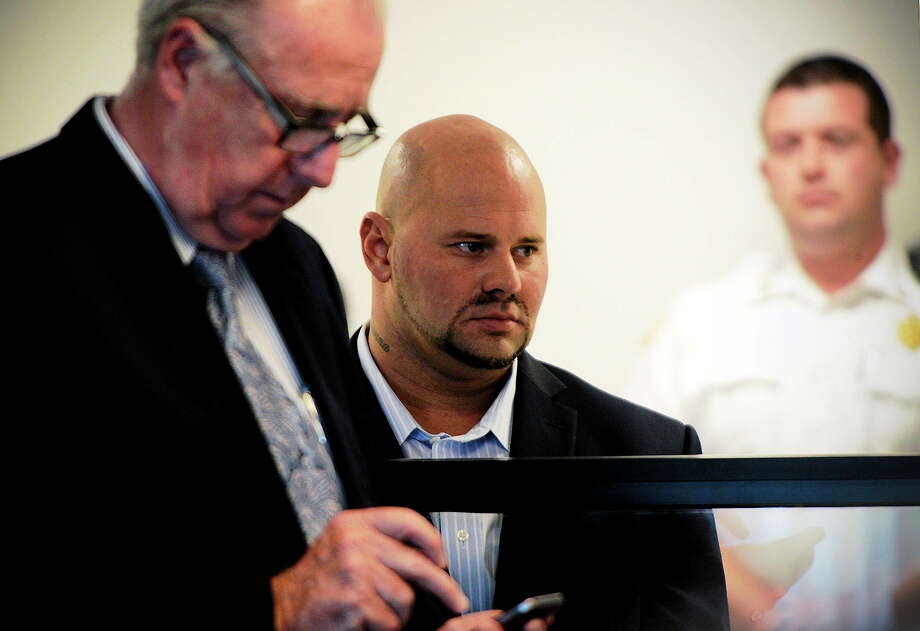 Jared Remy, son of Boston Red Sox broadcaster Jerry Remy, stands beside his attorney, Edward Ryan Jr., left, during his arraignment on Oct. 8 at Middlesex Superior Court in Woburn, Mass. Remy pleaded not guilty to murder and assault charges stemming from the Aug. 15 stabbing death of his girlfriend, Jennifer Martel. Photo: Ted Fitzgerald — Boston Herald  / Pool, Boston Herald