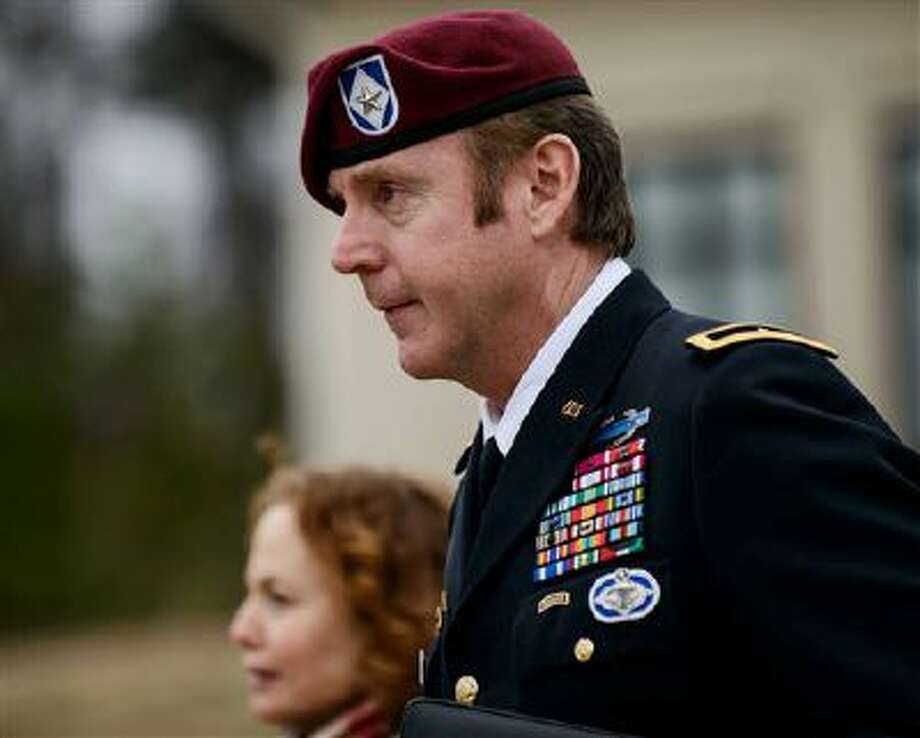 FILE - In this March 4, 2014, file photo, Brig. Gen. Jeffrey Sinclair leaves the courthouse following a day of motions at Fort Bragg, N.C. A military judge declined Monday, March 10, 2014, to dismiss sexual assault charges against Sinclair after reviewing what he said was evidence that political considerations influenced the military's handling of the case. (AP Photo/The Fayetteville Observer, James Robinson, File) Photo: ASSOCIATED PRESS / AP2014