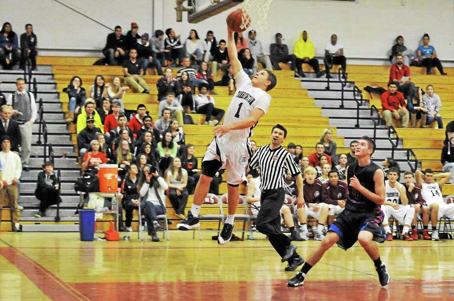 Torrington's Zak Mancini goes for a layup during the Red Raiders 84-64 win over St. Paul. Mancini scored 24 points in the win. Photo: Laurie Gaboardi — Register Citizen