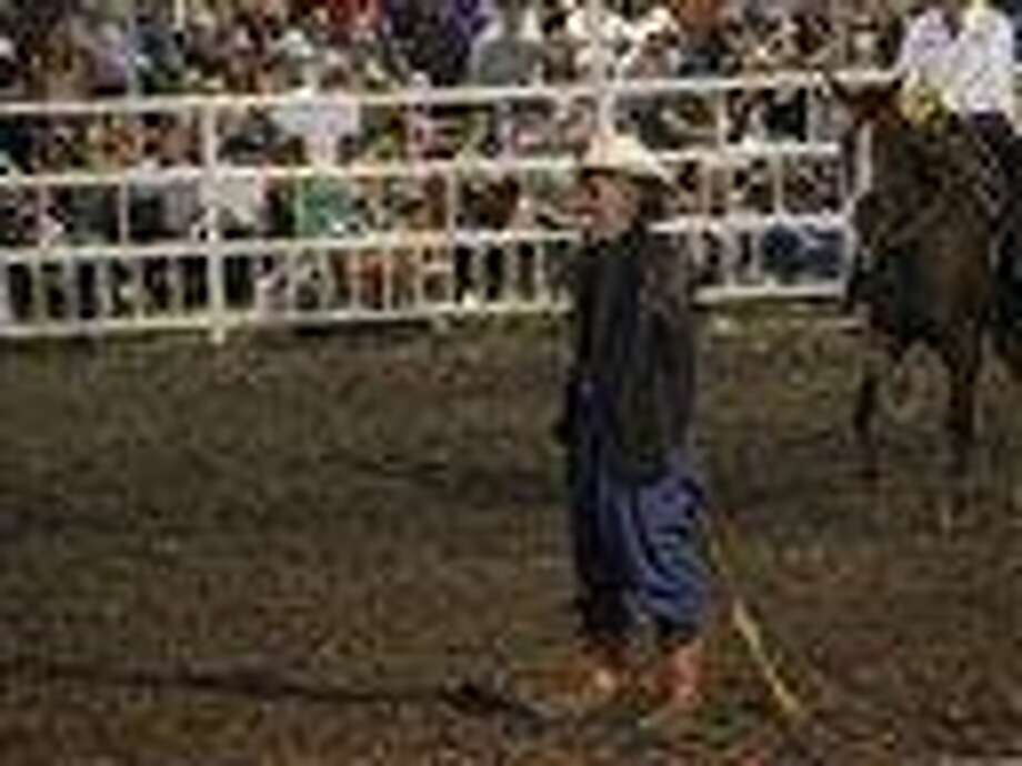 "This photo provided by Jameson Hsieh shows a clown wearing a mask intended to look like President Obama at the Missouri State Fair. The announcer asked the crowd if anyone wanted to see ""Obama run down by a bull,"" according to a spectator. ""So then everybody screamed. ... They just went wild,"" said Perry Beam, who attended the rodeo at the State Fair in Sedalia on Saturday Aug. 10, 2013.  State Fair officials apologized calling the display inappropriate and disrespectful. (AP Photo/Jameson Hsieh) Photo: AP / Jameson Hsieh"