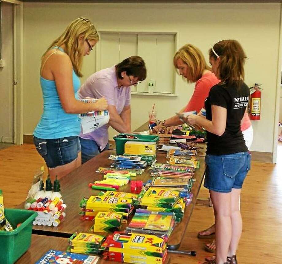 Volunteers from the Burlington Food Pantry handed out school supplies to students Monday. (Submitted photo)