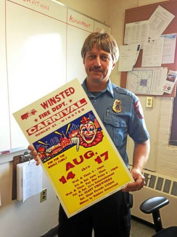 Capt. James Lagassie holds a flier for the Winsted Fire Department's upcoming carnival. (Mercy Quaye-Register Citizen)