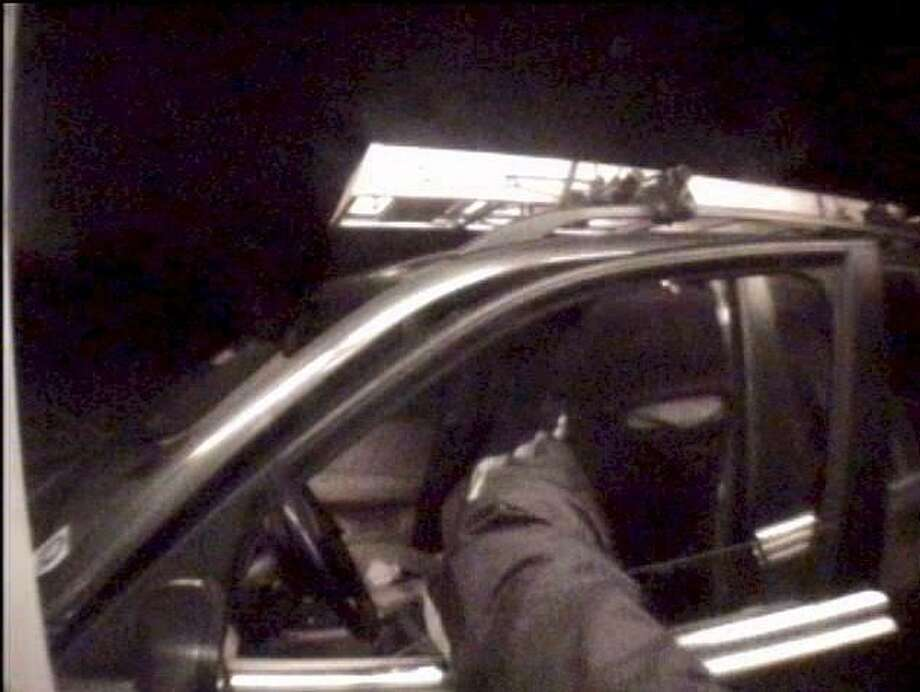 State police contributed photo of one of masked men wanted in connection with New Hartford home robbery on April 8, 2013.