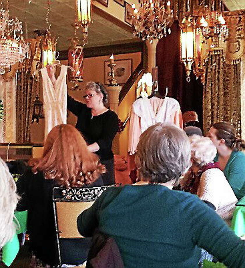 Submitted photo courtesy of Ginger Balch The grand finale of the afternoon was Ritz owner Karen OíDonnells' interesting peek into the Downton Abbey era of womens fashions, which included hats, purses, gloves and lingerie. Photo: Journal Register Co.