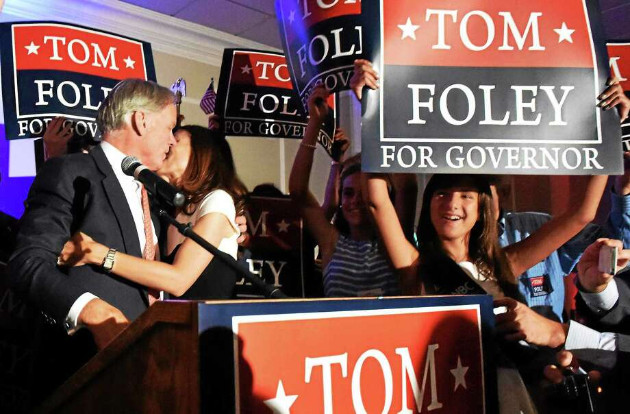 Republican gubernatorial candidate Tom Foley kisses his wife, Leslie, to cheers of supporters at the Villa Rosa Pontelandolfo Club in Waterbury Tuesday night after winning the Republican primary. Photo: Peter Hvizdak — New Haven Register    / ©Peter Hvizdak /  New Haven Register