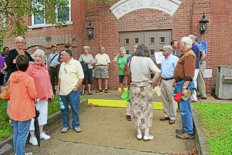 A group of citizens gathered out front of town hall Tuesday awaiting the meeting and showing support for Town Manager Dale Martin. Photo: Ryan Flynn — The Register Citizen
