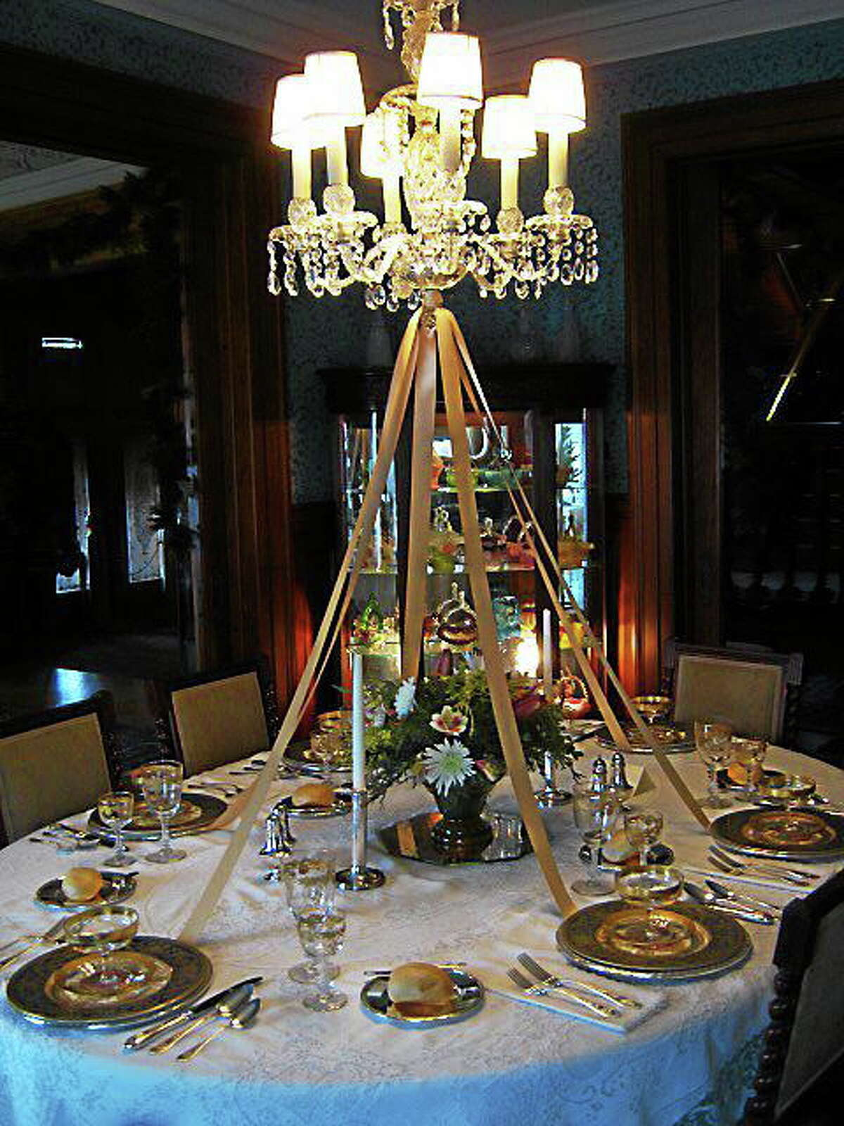Photographs courtesy of Mark McEachern The Hotchkiss-Fyler House, the gem of the Torrington Historical Society, is decorated for the holiday season and tours run through Dec. 29. Above, the dining room table is set for a Christmas feast.