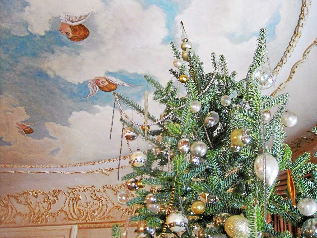 The Hotchkiss-Fyler House's painted ceiling accents the decorated Christmas trees that can be found inside the historic property this holiday season.