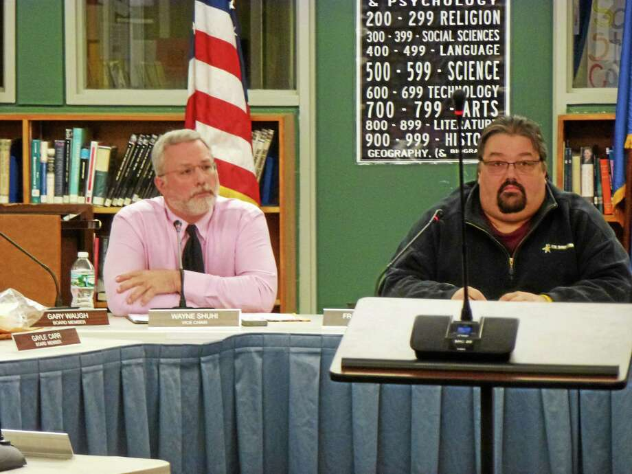 Board of Education Vice Chair Wayne Shuhi and Chairman Frank Simone discuss the bid for personal devices at Litchfield High School. Photo: Ryan Flynn—Register Citizen