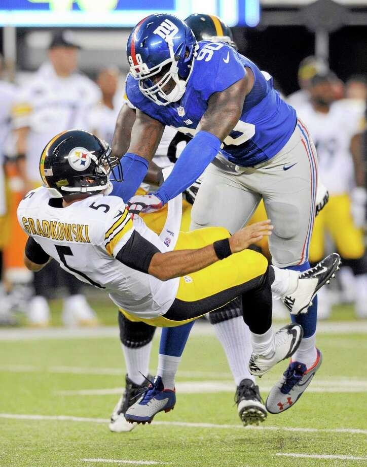 Giants defensive end Jason Pierre-Paul pressures Steelers quarterback Bruce Gradkowski during Saturday's preseason game. Photo: Bill Kostroun — The Associated Press  / FR51951 AP