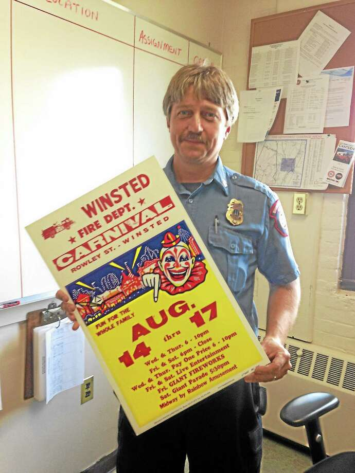 Capt. James Lagassie holds a flier for the Winsted Fire Department's upcoming carnival. Photo: Mercy Quaye—Register Citizen