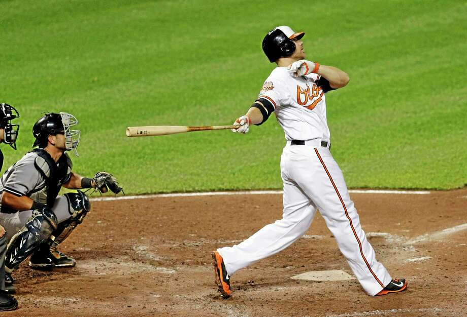 Orioles first baseman Chris Davis watches his two-run home run in the fifth inning Monday. Photo: Patrick Semansky — The Associated Press  / AP
