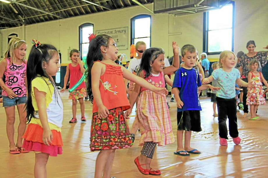 Children dance during an end of the summer reading party organized by the Torrington Public Library at the city's armory on Monday, August 12. The party was a reward for all the children who participated in the library's summer reading program. Photo: Esteban L. Hernandez—Register Citizen