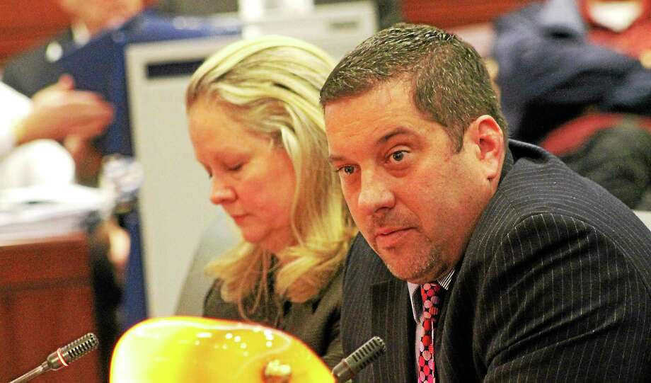 State Rep. Jay Case and selectman Candace Bouchard (left) spoke at a public hearing for H.B. 5342, a bill that would set a mandatory minimum jail time for public employees who steal from their town. Photo: Contributed Photo
