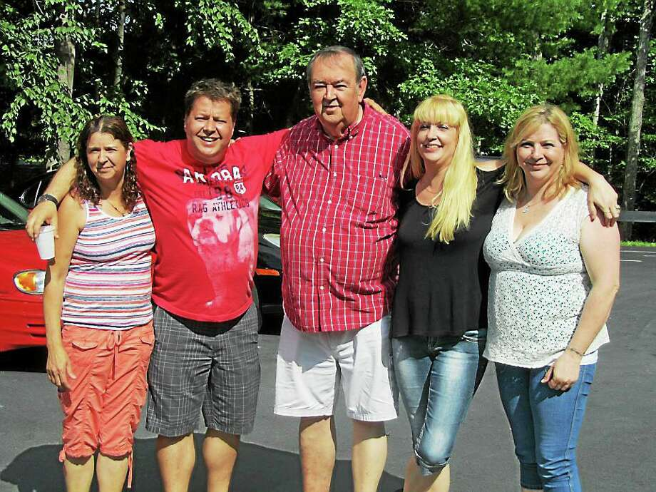 Siblings Allison Bianco, Roger Barton Jr., Jennifer Buhite and Melissa Beauregard pictured with their father Roger Barton Sr. in July 2012. Photo: Contributed Photo
