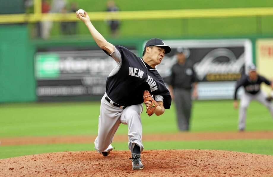 New York Yankees starter Masahiro Tanaka throws a pitch during the first inning of a spring training game against the Philadelphia Phillies on Thursday in Clearwater, Fla. Photo: Charlie Neibergall — The Associated Press  / AP