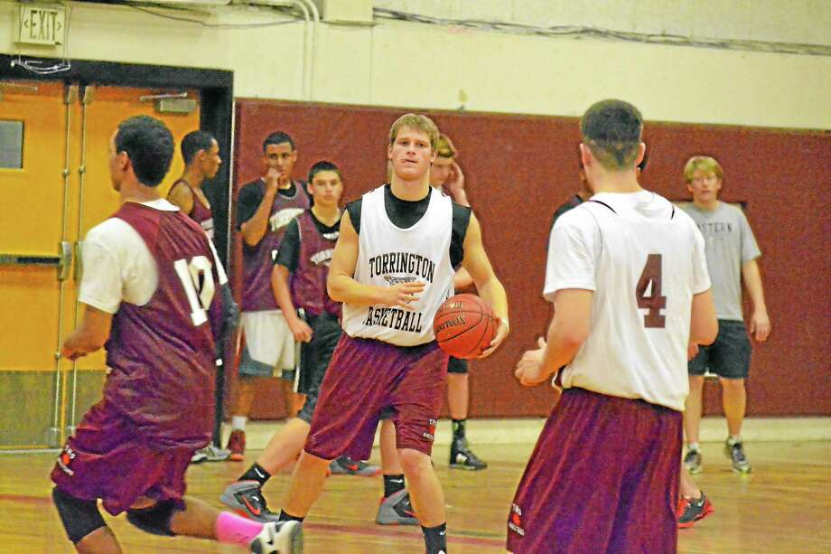 Torrington's Mitchell Zagrodnik looks to make a pass during Monday's practice. Photo: Pete Paguaga — Register Citizen