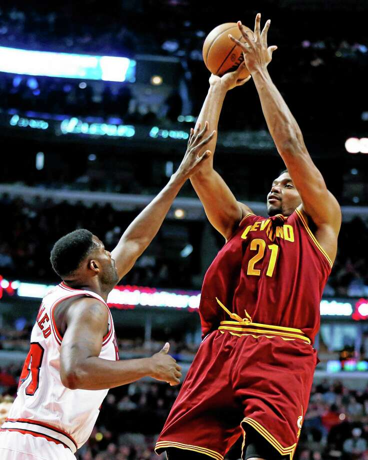 In this Dec. 21, 2013, file photo, Andrew Bynum shoots over Nazr Mohammed during a game in Chicago. More than a month after signing the free agent center, Bynum is expected to make his debut with Indiana on Tuesday against Boston. Photo: Andrew A. Nelles — The Associated Press  / FR170974 AP
