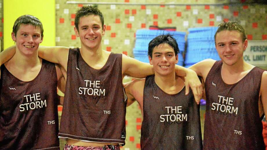 """""""The Storm"""" is the nickname for the Torrington Red Raiders 200 medley relay team. The members of """"The Storm"""" from left to right, Matt Traub, Griffin Pelkey, Brad Nichols and Jack Wassik. Photo: Pete Paguaga — Register Citizen"""