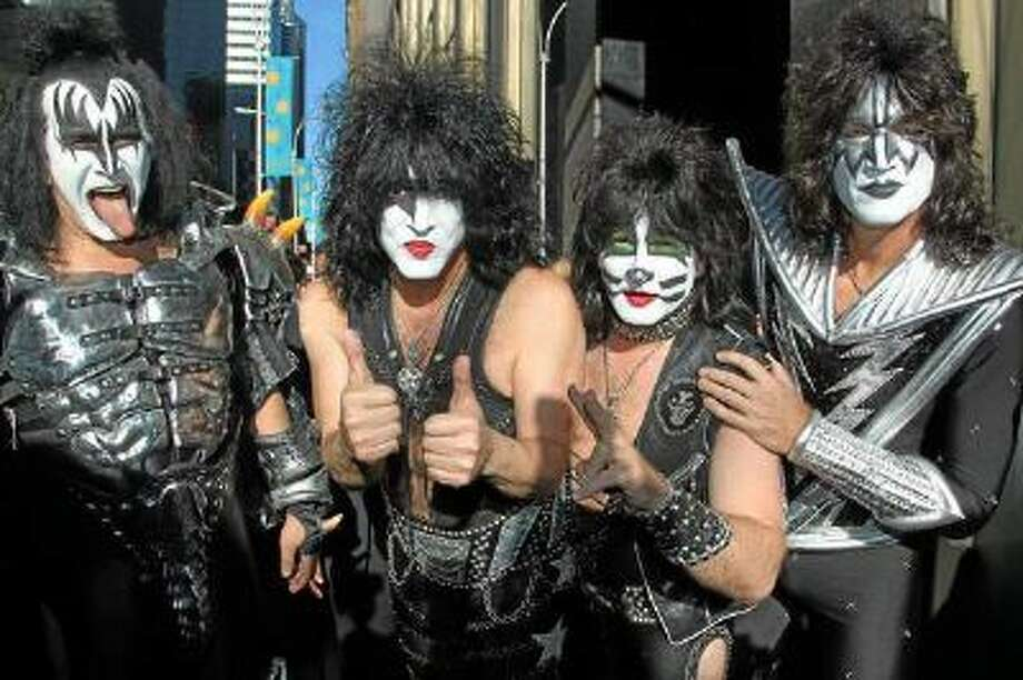 """This Oct. 11, 2012, file photo released by Starpix shows, from left, Gene Simmons, Paul Stanley, Eric Singer, Tommy Thayer of KISS as the band arrives at SiriusXM offices to promote their latest release """"Monster,"""" in New York. Kiss will be inducted into the 2014 Rock and Roll Hall of Fame on April 10 at the Barclays Center in New York."""