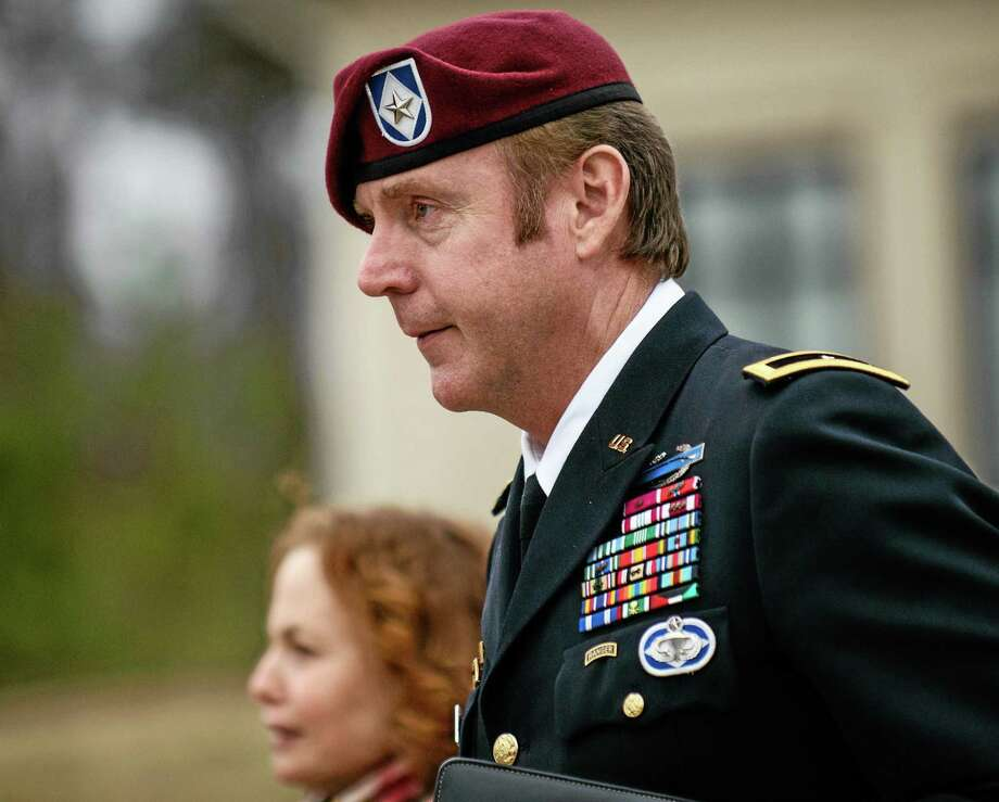 FILE - In this March 4, 2014, file photo, Brig. Gen. Jeffrey Sinclair leaves the courthouse following a day of motions at Fort Bragg, N.C. A military judge declined Monday, March 10, 2014, to dismiss sexual assault charges against Sinclair after reviewing what he said was evidence that political considerations influenced the military's handling of the case. (AP Photo/The Fayetteville Observer, James Robinson, File) Photo: AP / The Fayetteville Observer