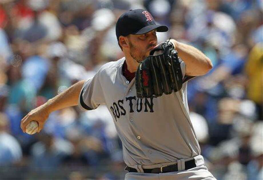 Boston Red Sox pitcher John Lackey throws to a batter in the first inning of a baseball game against the Kansas City Royals at Kauffman Stadium in Kansas City, Mo., Sunday, Aug. 11, 2013. (AP Photo/Colin E. Braley) Photo: AP / FR123678 AP