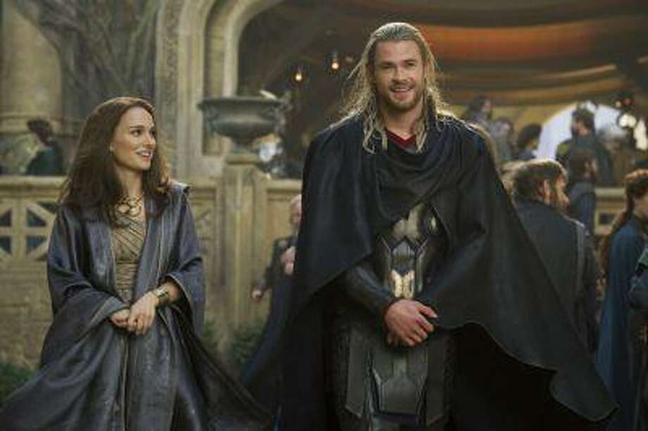 """This publicity photo released by Walt Disney Studios and Marvel shows Natalie Portman, left, as Jane Foster and Chris Hemsworth as Thor, in Marvel's """"Thor: The Dark World."""" Photo: AP / Walt Disney Studios/Marvel"""