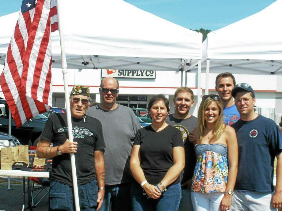Photo by Stephen Underwood From left are Art Melycher, organizer of the event, Marc and Tracy Melanson, Andrew Melanson, who serves n the Air Force and is due for deployment in September; Heather Boyd, David Melanson, and Sean Boyd. Photo: Journal Register Co.