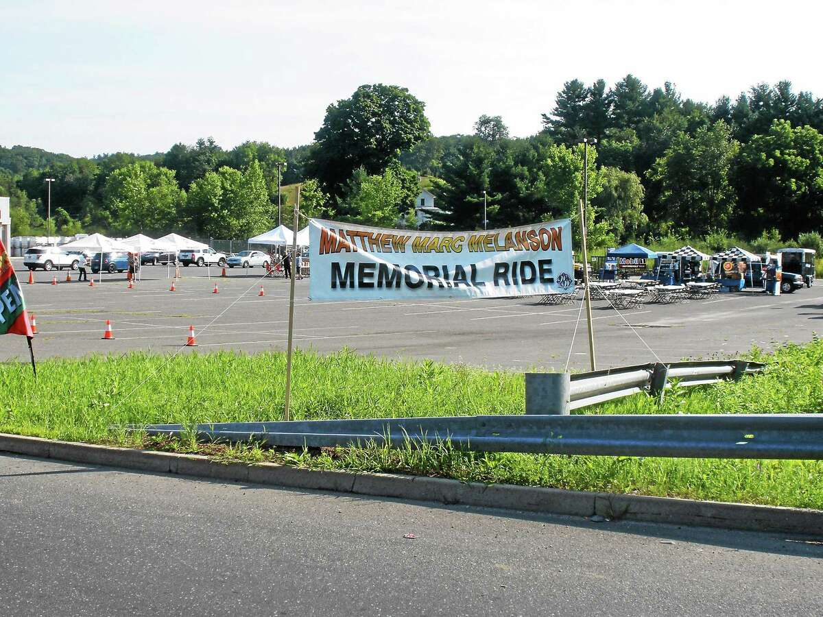 Photo by Stephen Underwood A banner welcomes riders to the Tractor Supply parking lot in Winsted at the conclusion of Sunday's charity ride.