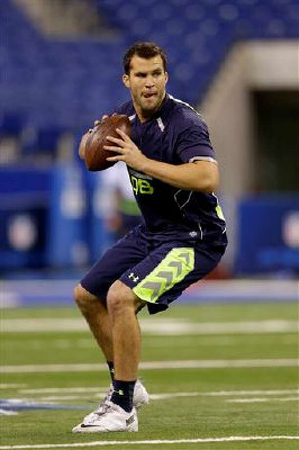 Central Florida quarterback Blake Bortles throws during a drill at the NFL football scouting combine in Indianapolis, Sunday, Feb. 23, 2014. (AP Photo/Michael Conroy) Photo: AP / AP