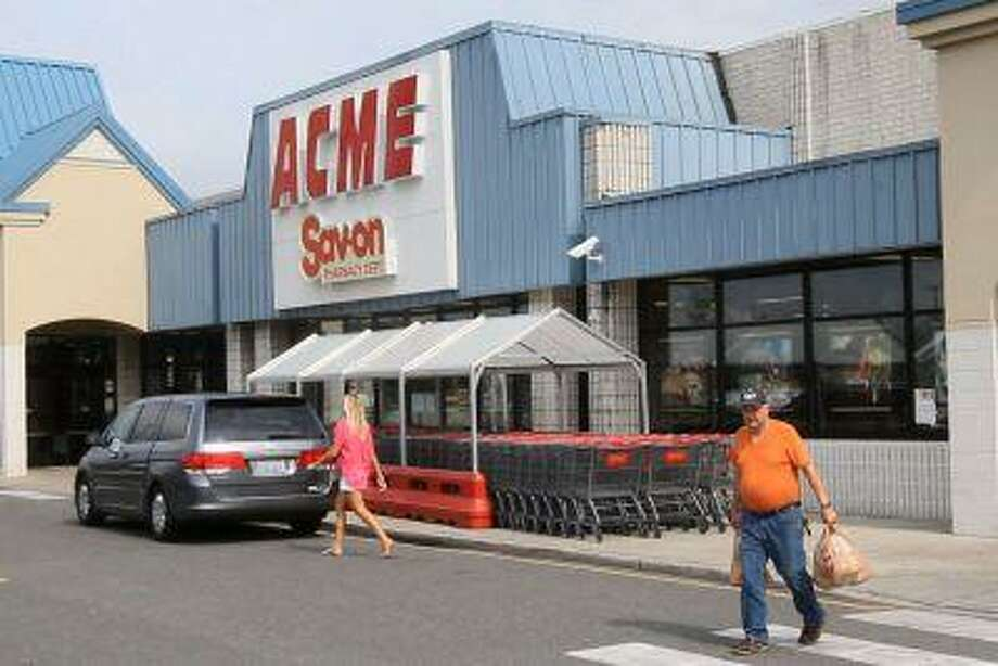 Shoppers walk outside an Acme store on Route 9 in Little Egg Harbor, N.J., where one of the winning lottery tickets in the $448 million Powerball drawing was sold. Photo: AP / The Asbury Park Press