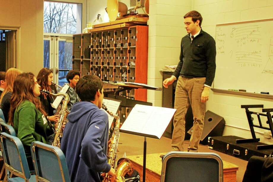 Dan Porri, director of instrumental music at LHS, rehearses with students Tuesday for the Southern New England Jazz Festival. Photo: Shako Liu — Register Citizen
