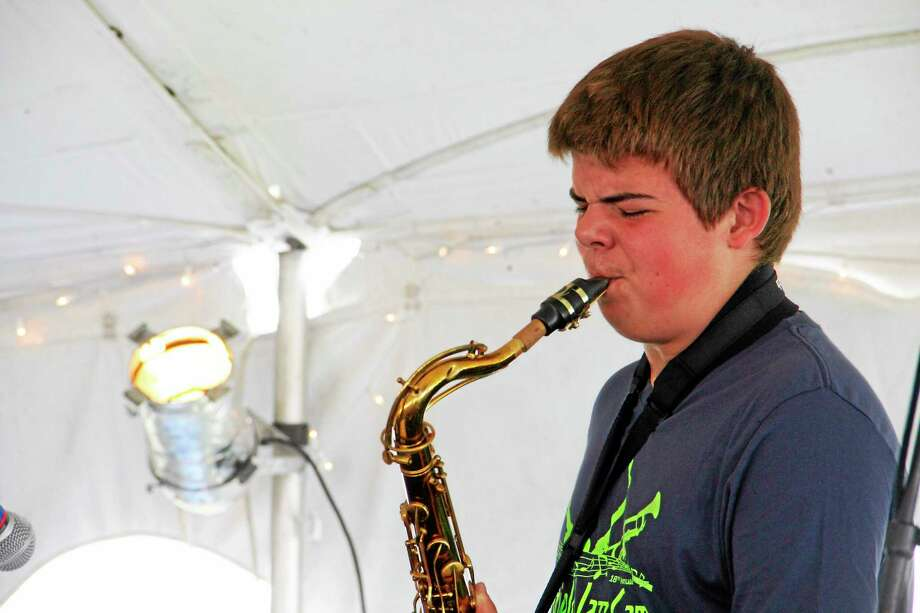 Ian Anderson, 14, of Guilford, performs a solo on a tenor saxophone during the Litchfield Jazz Festival on Saturday, August 9, 2014. Anderson was one of several members of the Litchfield Jazz Camp who performed on Saturday. Esteban L. Hernandez Register Citizen Photo: Journal Register Co.