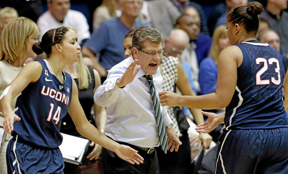 Connecticut's Bria Hartley (14) and coach Geno Auriemma congratulate Kaleena Mosqueda-Lewis (23) as Mosqueda-Lewis leaves the court during the second half of Tuesday's game. Connecticut won 83-61. Photo: Gerry Broome — The Associated Press  / AP
