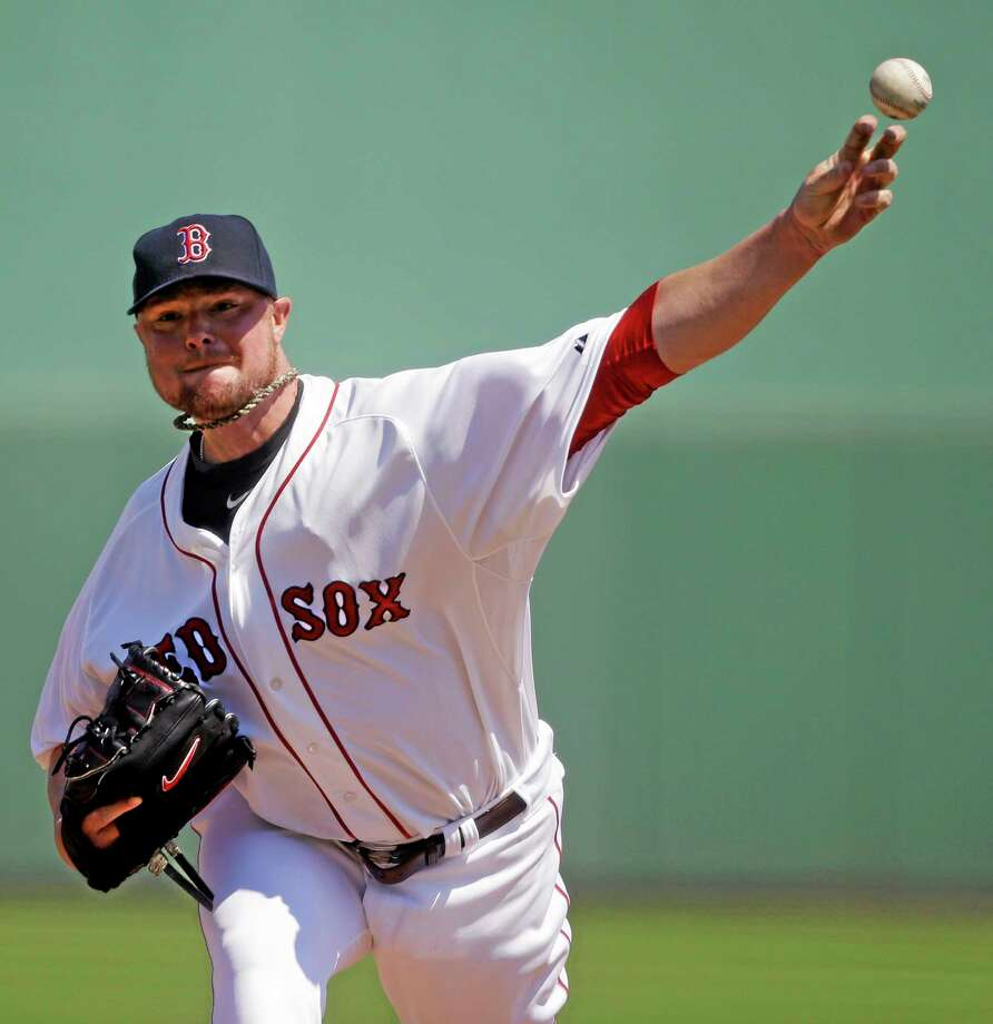 Boston Red Sox starting pitcher Jon Lester throws in the first inning of a spring training game against the Tampa Bay Rays in Fort Myers, Fla., on Monday. Photo: Gerald Herbert — The Associated Press  / AP